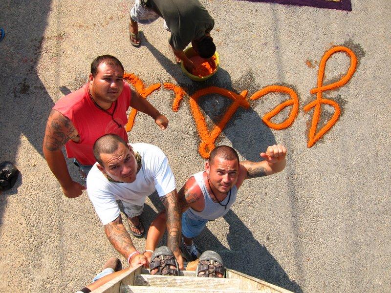 Guys holding ladder